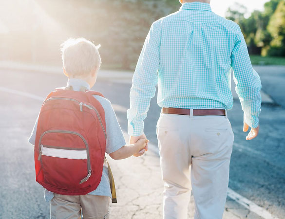 Father and son walking to school.