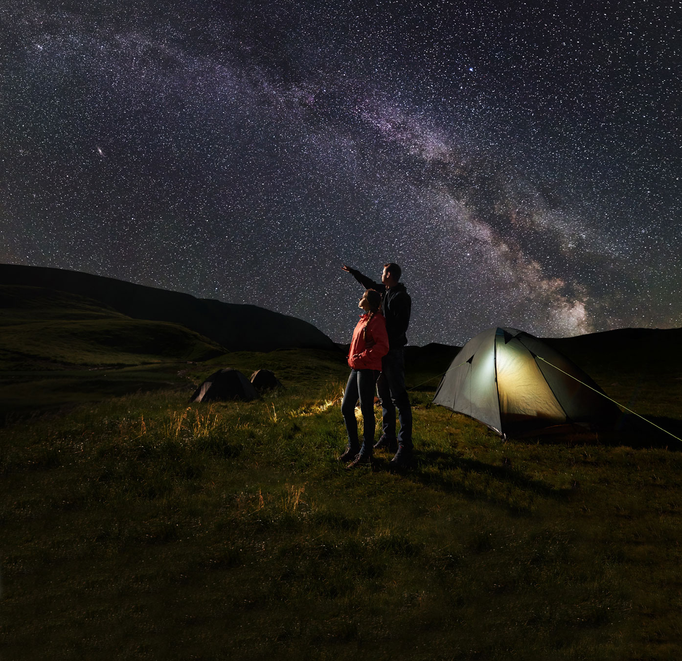Man and woman looking at a starry sky
